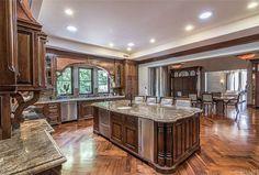 A chef's kitchen in rich browns.