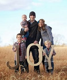 Giant wooden letters from Home Depot - spray paint them gold for your Christmas card photo