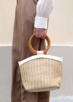 Soft Straw Bag w/Off White, Vegan Leather Trim & Strap. Lined Interior w/Zip Pocket. Gold Hardware x x Imported Wooden Handle Bag, Wooden Bag, Wooden Rings, Basket Bag, Summer Bags, Textiles, Cloth Bags, Fashion Handbags, Couture