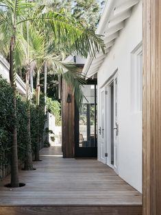 A reconfigured California bungalow with luxe finishes This side entrance features a decked path and palm trees and star jasmine plantings. Australian Interior Design, Interior Design Awards, Australian Homes, California Bungalow, California Homes, Pacific Homes, House Entrance, Outdoor Areas, Outdoor Patios