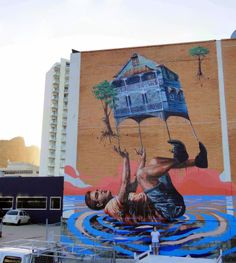 Fintan Magee just sent us a series of pictures from his newest street art mural which he just completed somewhere on the streets of Townsville in Australia.