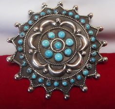 Handmade Sterling Silver & Turquoise Navajo Pin Brooch Pendant.....would be fun to collect different brooches and adorn a denim jacket...
