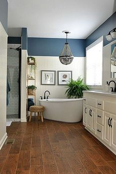 Navy blue and white master bathroom designs.