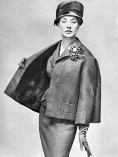 Marie-Thérèse in green Prince of Wales check suit with short jacket-cape lined in black otter by Pierre Balmain, photo by Georges Saad, 1956