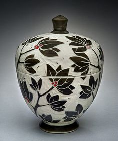 Leaf and berry scraffito lidded jar – Kathy King.  This blog got it wrong.  http://www.veniceclayartists.com/  The real artist is Karen Newgard find work at  http://karennewgardpottery.com/lidded-forms/