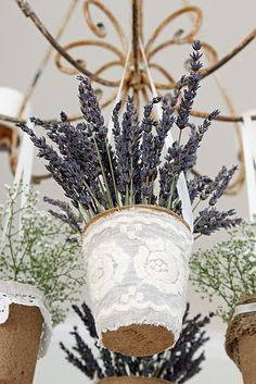 What a great idea for an outdoor wedding or event! Hang decorative containers filled with lavender from an antique chandelier! Adorable and very inexpensive to make <3