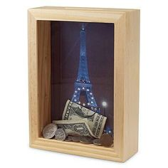 Put what you are saving for in shadow box and cut slit to put money in it
