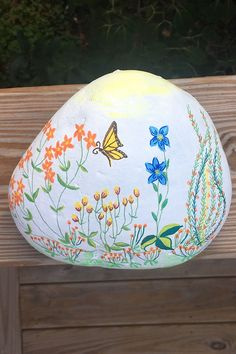 This finished painted rock features a yellow butterfly fluttering over a colorful garden of flowers. You'll receive the same hand painted rock seen in the pictures and video. Painted Rocks For Sale, Hand Painted Rocks, River Stones, Colorful Garden, Door Stop, Fireplace Mantels, Beautiful Paintings, Butterfly, Etsy Shop