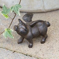 "Small Rustic Flying Pig Figurine, Iron.....Measures approximately 4"" L x 3"" H.....This small rustic flying pig figurine is a wonderful tabletop accent and can be used indoors or outdoors. Cast iron."