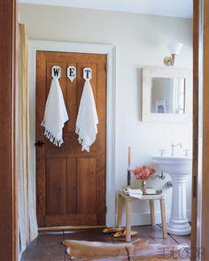 {ELLE Decor} love those hooks hahah cute for a bathroom