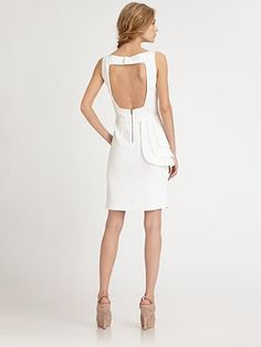 The cut-out back and side peplum are beautiful.