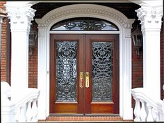 """Door Style DbyD-1052.   This intricate Front Exterior Entry has Double Mahogany 36"""" x 83"""" Style """"F"""" Doors with a Elliptical Transom.  The Leaded and Beveled Glass was created by Doors by Decora.  The Hardware is Baldwin Bristol 6963.  The Stain Color is Traditional Mahogany."""