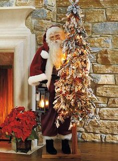The gorgeous Merriment Santa welcomes guests in your foyer or stands stately beside your hearth during the Christmas season.