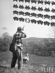 1960's original Space Invaders attempting to land in rural Kentucky Field.  Old Zeb Hatfield and his trusty dog will have none of that!
