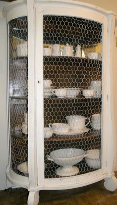 Antique, china cabinet.  Chicken Wire.  Painted white & lightly distressed.