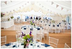 Marquee decoration, small centrepieces - helps that there is colour accents on tables with serviettes?