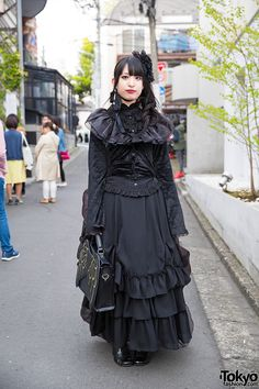19-year-old Watanabe on the street in Harajuku wearing a gothic lolita outfit by the Japanese brand Innocent World.