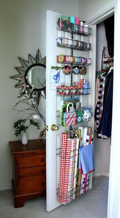 Store wrapping paper behind the closet door for easy access but out of the way. http://hative.com/creative-wrapping-paper-storage-ideas/