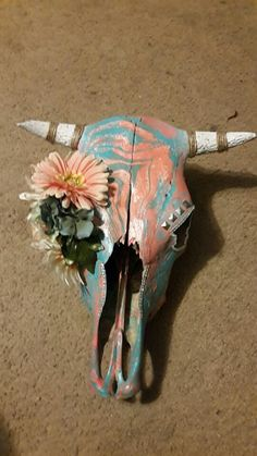 Hydro dipped cow skull that I did!!! I love it but sad to see it go but I'll see it everyday at my moms !! :))