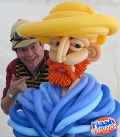 Balloon artist Phileas Flash poses with his balloon art version of Van Gogh's Self portrait in straw hat