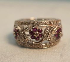 18k White Gold Encore LeVian Ruby Diamond Flower Cluster Band .... In love!!! If this was still available, I'd buy it in a heart beat!