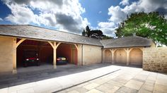 Oak frame Garage with stone and oak cladding