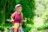 Beautiful_bike : Children girl riding bicycle outdoor in forest smiling with helmet
