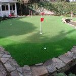 http://www.landscaping.ie - synthetic golf putting green in a garden design.