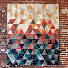 "Sew with equilateral triangles in this fun, modern quilt pattern. Cut triangles with a standard acrylic ruler or provided template. 68"" x 78"" Kit includes: 7 1/8 yards of fabric for top and binding -"