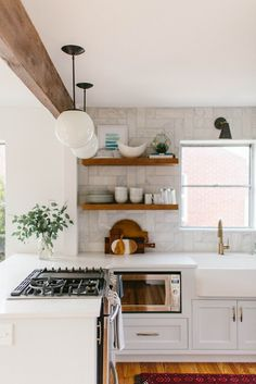 I would love to do this to my kitchen. Knock out the wall between the kitchen and dining and move the stove. I would put a bar stool area on the other side of the stove.