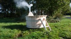 outdoor wood-fired hot tub.  Someday.  Just you wait.  I'll have this yet, my pretties!