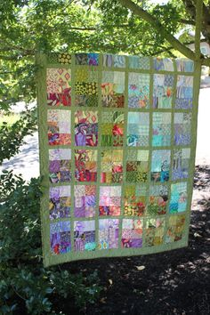 If you like unique quilts, this beauty is for you! While this quilt is made from scraps of fabrics, the careful placement of color creates a lovely gradation effect. It is almost as if you are gazing out a window at a field of flowers. This is an original pieced design and its scrappiness will ensure you have a one of a kind quilt. This quilt measures 45 x 64 inches. Perfect size for storing on the back of a sofa or hanging over a chair until you need it.