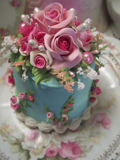 "This is a ""fake cake"" Would make a pretty wedding cake topper or table decoration."