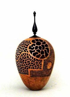 Maple, pierced and textured. Maple, pierced and textured. The ebony finial is removable. 5 in. dia. x 8 inches high. Artist:  Wally Dickerman.
