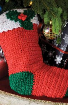 crochet holly stocking - a bit bright on the colors, but I'd love to learn how to crochet a/o knit christmas stockings