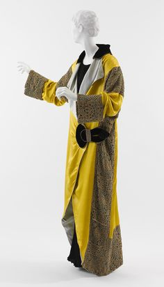 Paul Poiret: Opera Coat (1982.350.2) | Heilbrunn Timeline of Art History | The Metropolitan Museum of Art | Yellow and pale blue silk satin, black silk velvet, turquoise silk satin with gold and silver filet crocheted overlay, and silver filet trapunto half-belt and trim