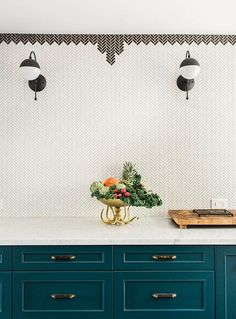 Parisian/Moroccan inspired kitchen - mini herringbone tile backsplash, colorful cabinetry
