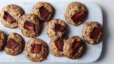 In the venerable tradition of kitchen sink and compost cookies aka cookies with lots of (unexpected) add-ins, comes these salty-sweet treats. We use dark chocolate to balance the saltiness of the bacon pieces and potato chips.
