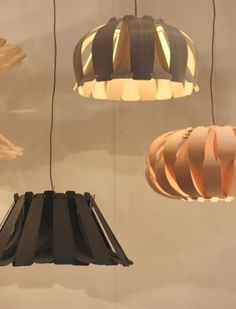 Argentina company Weplight revealed a new collection of stunning wooden lights. Its designers have worked with the company's own flexible wood veneer since 2001, allowing them to create these elegantly curved fixtures.