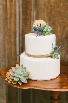 Twine, succulents, eryngium on this wedding cake.