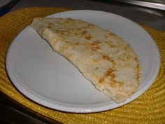 LIGHT PIADINA -For 1 piece:75gr flour with yeast and a pinch of salt.Add a spoon of extra-vergin oil,mix and then add warm water (not too hot) to obtain a soft dough,working with your hands.Use a rolling pin to shape and thin it.Cook in a crepes pan for a couple of minutes one side first,than hole with a fork and turn it to the other side.Fill it with ham,cheese or what you love. Enjoy it!!!