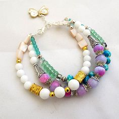 Stunning Boho fashion bracelet with a range of white, green and purple jade gemstones, white shell beads and lovely green glass beads. Absolutely stunning bracelet. - See more at: http://www.luxiere.co.uk/index.php/hi-fashion/bracelets-bangles-1/