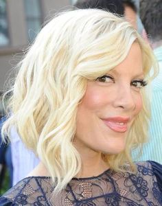 Tori Spelling, fine hair that is shoulder length, long, uneven layers that begin at least 2 inches below the chin. Hairstyles for Round Faces: The 20 Most FlatteringCuts.
