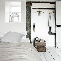 Minimal and natural white bedroom    This simple and minimal bedroom is beautiful with the carefully placed accessories. The combine of wood and white make the bedroom strong.  Source:   http://www.housetohome.co.uk