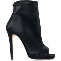 This bootie by Oscar de la Renta features a black buck leather body and open toe. Back Zip Closure. Buck Leather. Calf Inner. Made in Italy. Size & Fit Heel He…