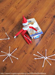 Elf on the Shelf Ideas –  Elf Makes Q-Tip Snowflakes plus daily idea and FREE Elf on the Shelf Printable Notes.