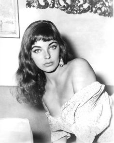 Joan Collins (1933 - ) | Starred in The Girl in the Red Velvet Swing, Rally 'Round the Flag, Boys!, Land of the Pharaohs, Island in the Sun, & The Virgin Queen