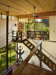 On Puget Sound, activist and filmmaker Anna Hoover collaborated with Les Eerkes, a principal at Olson Kundig Architects, on a 693-square-foot studio in the woods. Using freecycled materials and a six-footed foundation to rein in construction costs, Hoover and Eerkes created a distinctive structure that treads lightly on the land.l