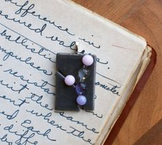 Contemporary pink, gray and purple fused glass necklace.