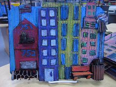 Cardboard Cityscape art project - use card board & popcicle sticks. Paint all black & then use oil pastels for color.